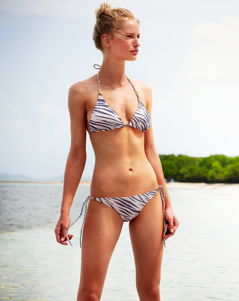 Shop the daring navy and white swim stories this season, whether it be the new zebra print story, Ma...