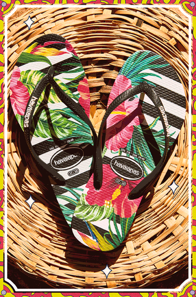 Keep the spirit of the tropics alive year round with the Slim Tropical Floral flip flop. Featuring v...
